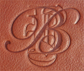 blind debossed monogram on leather pad holder